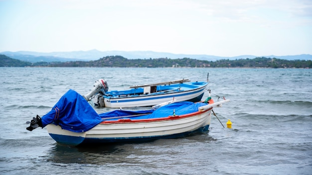 Two wooden boats with engines near the aegean sea coast in ormos panagias