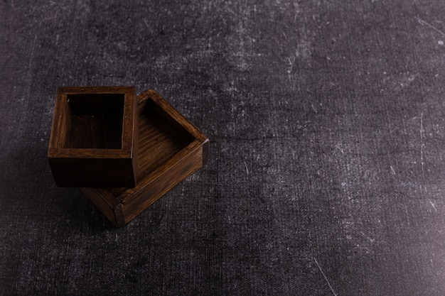 Two wooden food boxes on a dark background