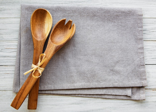 Two wooden salad spoons on linen cloth