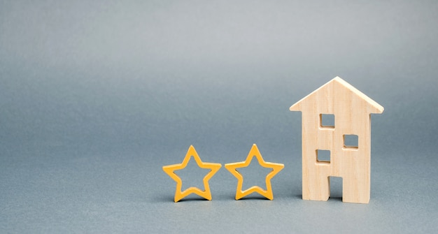 Two wooden stars and a house.