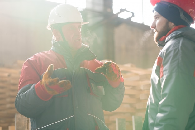 Two workers communicating
