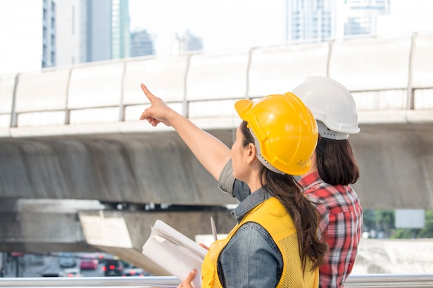 Two working woman are working together at construction site