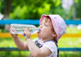 Two-year child drinks from  bottle