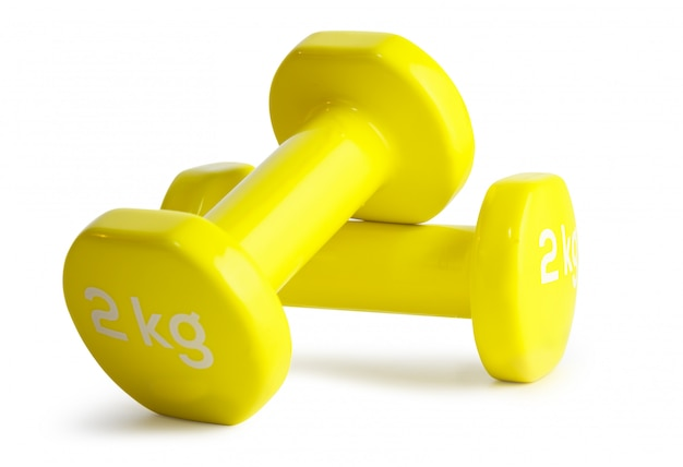 Two yellow  dumbbells isolated on white background with clipping path