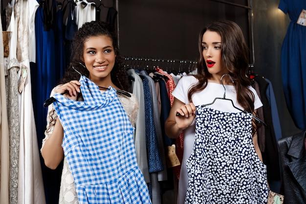 Two young beautiful girls shopping in mall.