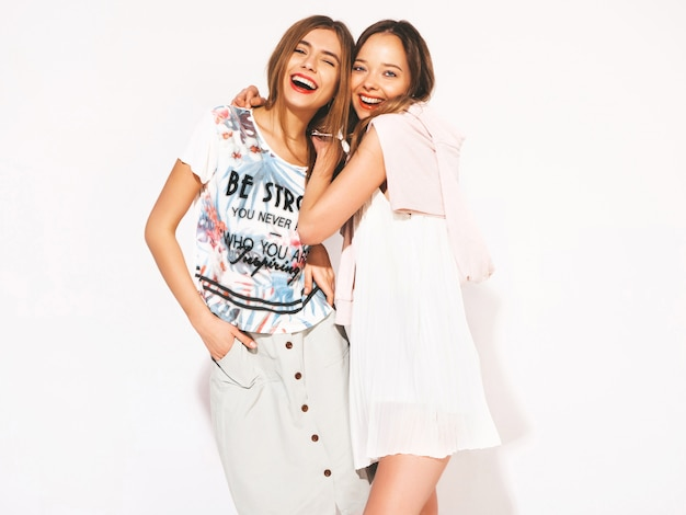 Two young beautiful smiling girls in trendy summer casual clothes. sexy carefree women. positive models