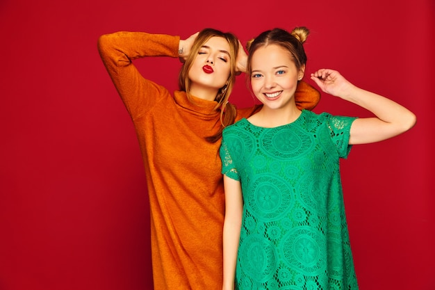 Two young beautiful women posing in trendy clothes