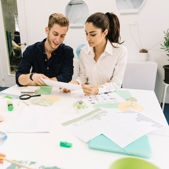 Two young businesspeople working in office