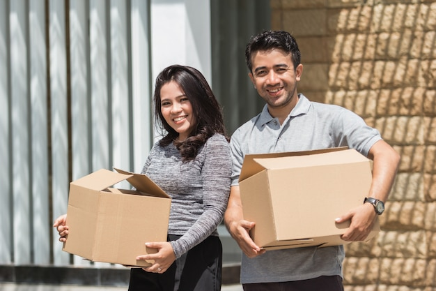 Two young couple moving to a new house