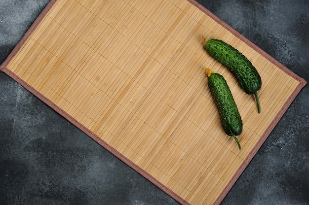 Two young cucumbers on a thorny background
