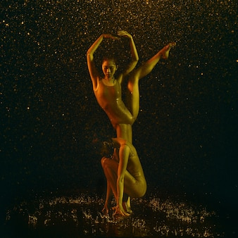 Two young female ballet dancers under water drops Free Photo