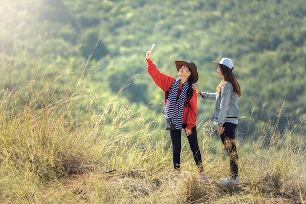 Two young female tourist takes travel selfie