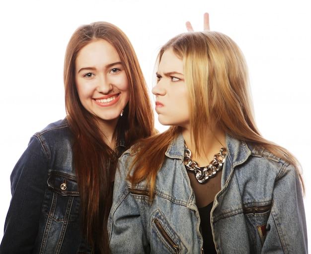 Two young girl friends  having fun.