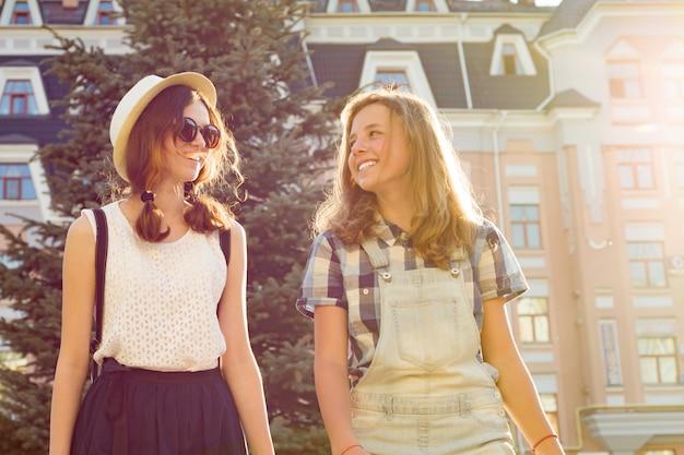 Two young girlfriends having fun in city
