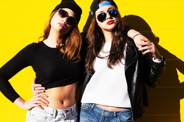Two young girlfriends in sunglasses having fun. lifestyle.