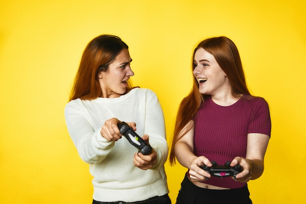 Two young girls are playing a game