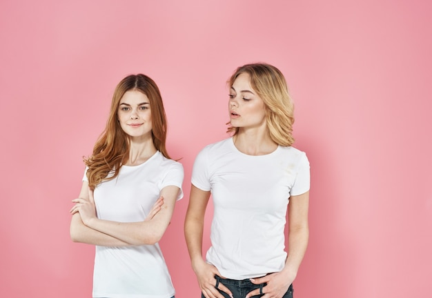 Two young girls lifestyle t shirts fashion pink background