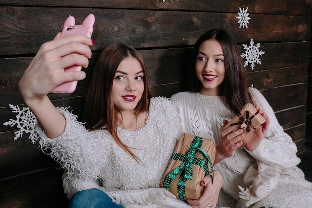 Two young girls make salfie