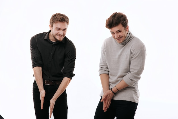 Two young men enjoying winning,  isolated white space, copy space, facial emotions positive