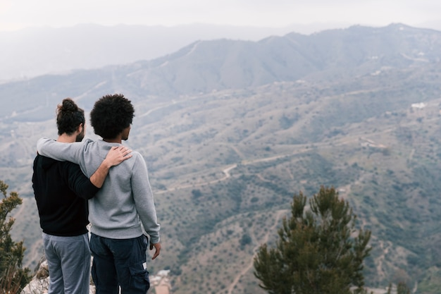 Two young men over looking the mountain landscape