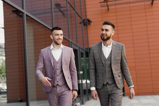 Two young modern businessman, walking in the city, business, work concept