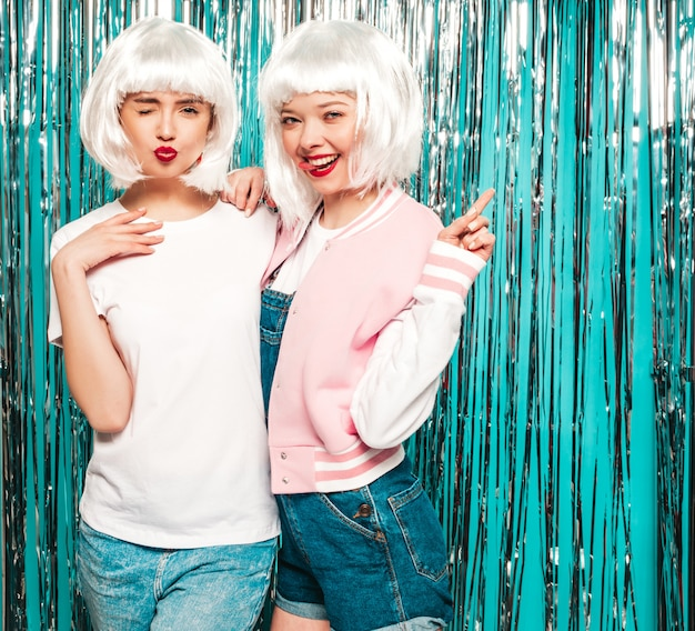 Two young sexy smiling hipster girls in white wigs and red lips.beautiful trendy women in summer clothes summer