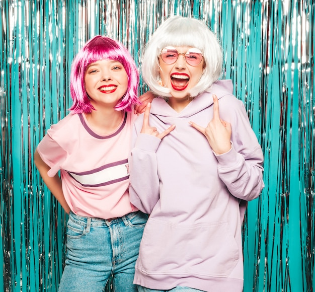 Two young sexy smiling hipster girls in white wigs and red lips.beautiful trendy women in summer clothes