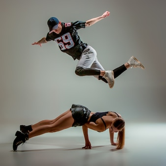 The two young woman and boy dancing hip hop