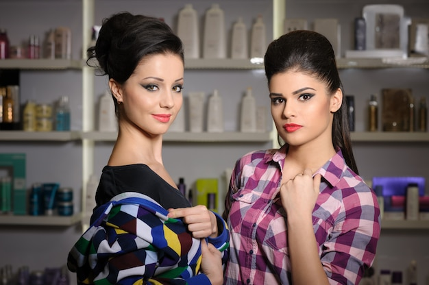 Two young women in cosmetics store