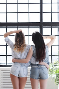Two young women hanging out together