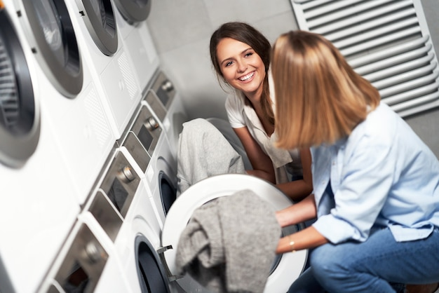 Two young women in laundry room