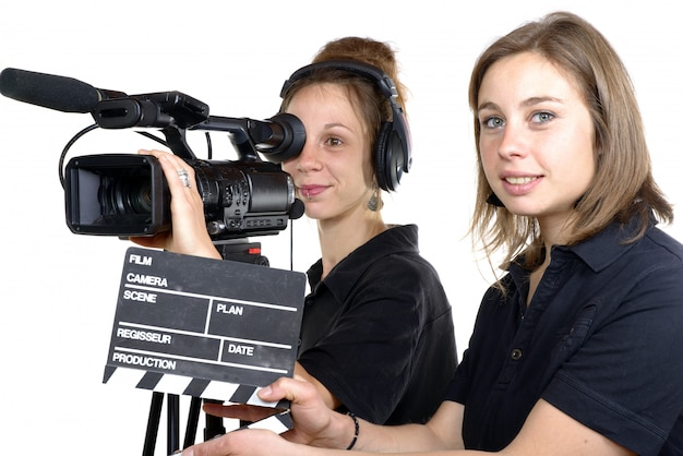 Two young women with a video camera