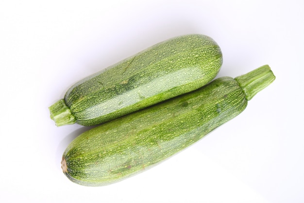 Two zucchini on a white background