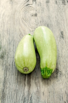 The two zucchini on wooden table