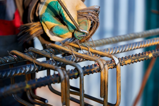 Tying reinforcing steel bars rebar for the construction.