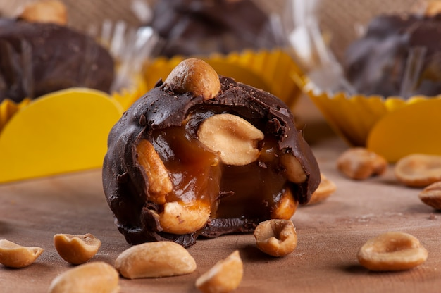 A type of brigadeiro called charge, with dulce de leche and peanuts. party candy. Premium Photo