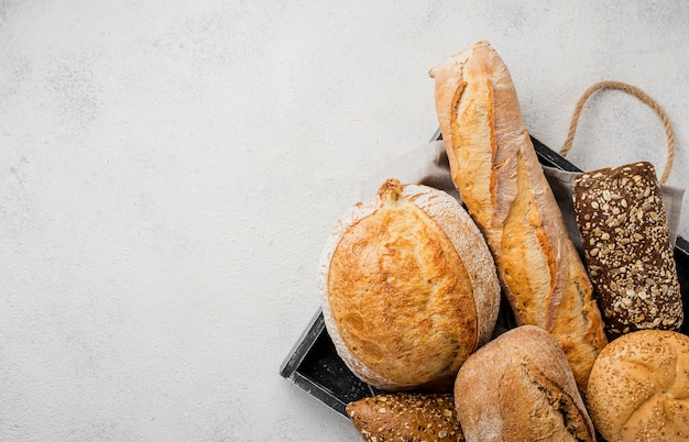 Types of bread on tray and copy space