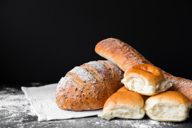 Types of fresh bread with flour on cloth
