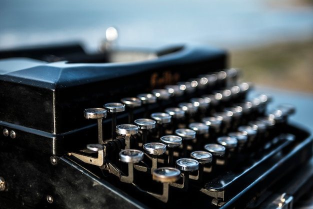 Typewriter on the background of the sea at dawn. summer beach