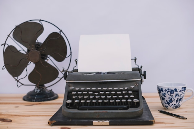 Typewriter between cup and fan