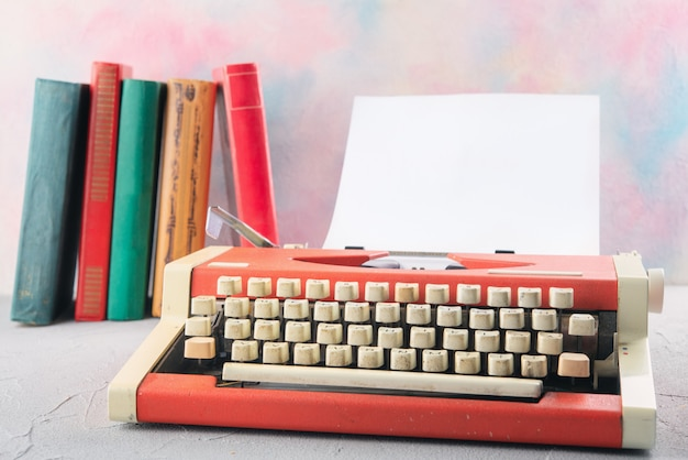 Typewriter on the table with books