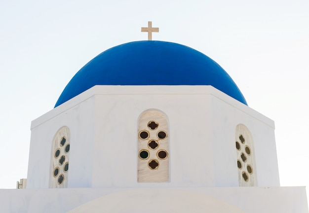 Typical blue cupola of a church in santorini