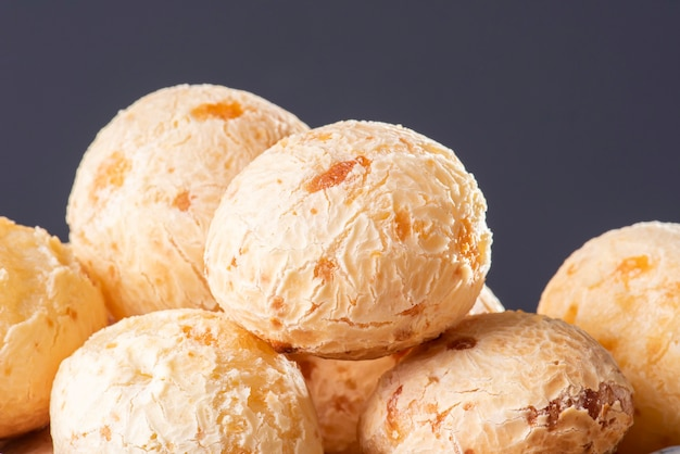 Typical brazilian cheese bread. close-up photo of some cheese bread. grey background.