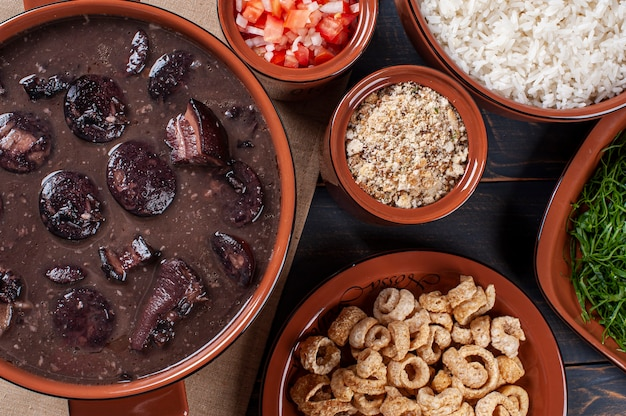 Typical brazilian dish called feijoada. made with black beans, pork and sausage. top view