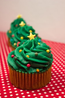 Typical christmas sweets. christmas tree shaped cupcakes