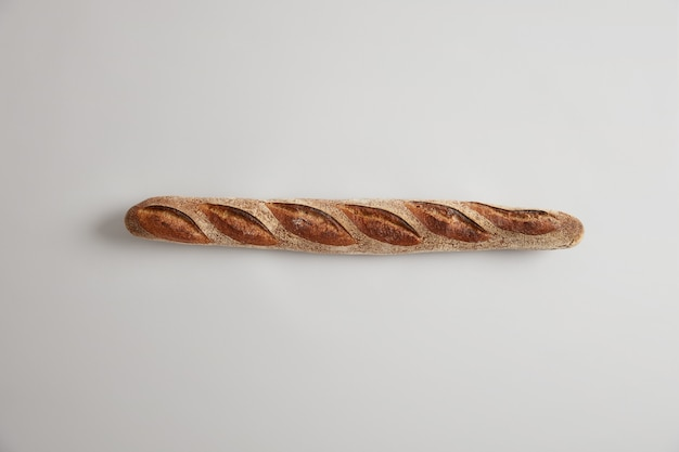 Typical french bread. long thin appetizing baguette with perfect aroma, crisp crust, just baked in bakery, commonly made from basic lean dough, can be sliced or added to your dishes. bakery concept