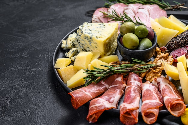 Typical italian antipasto with prosciutto, ham, cheese and olives.
