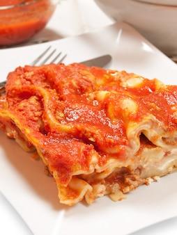 Typical italian food lasagne stuffed with tomato sauce