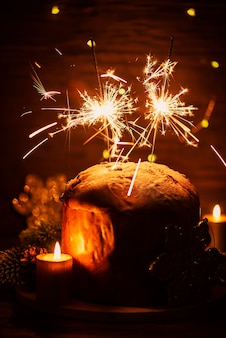 Typical italian panettone with sparklers