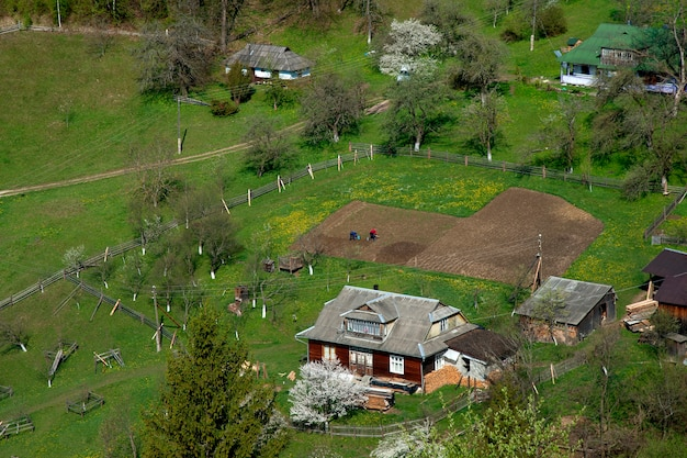 Typical landscape of the ukrainian carpathians with private estates.mountain wooden huts